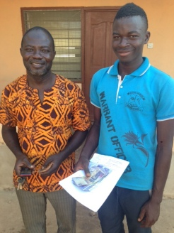 Gunwagre headmaster Agua and entering high school student Dennis. They stopped at our room on the way to pay school fees.